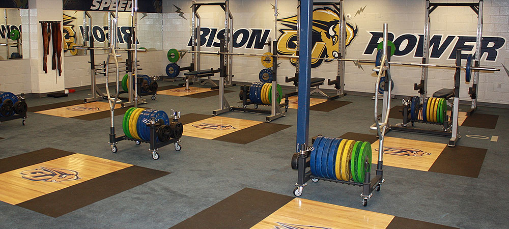 Gallaudet weight room with various weight stations and weights being shown.