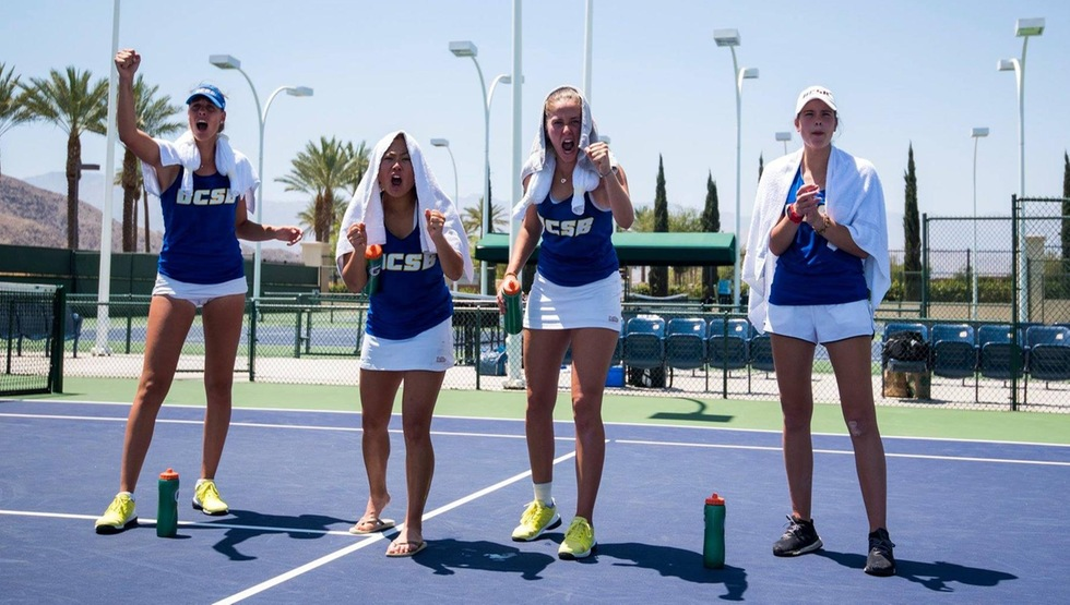 UCSB women's tennis players cheering as a match takes place (Photo by Josh Barber)