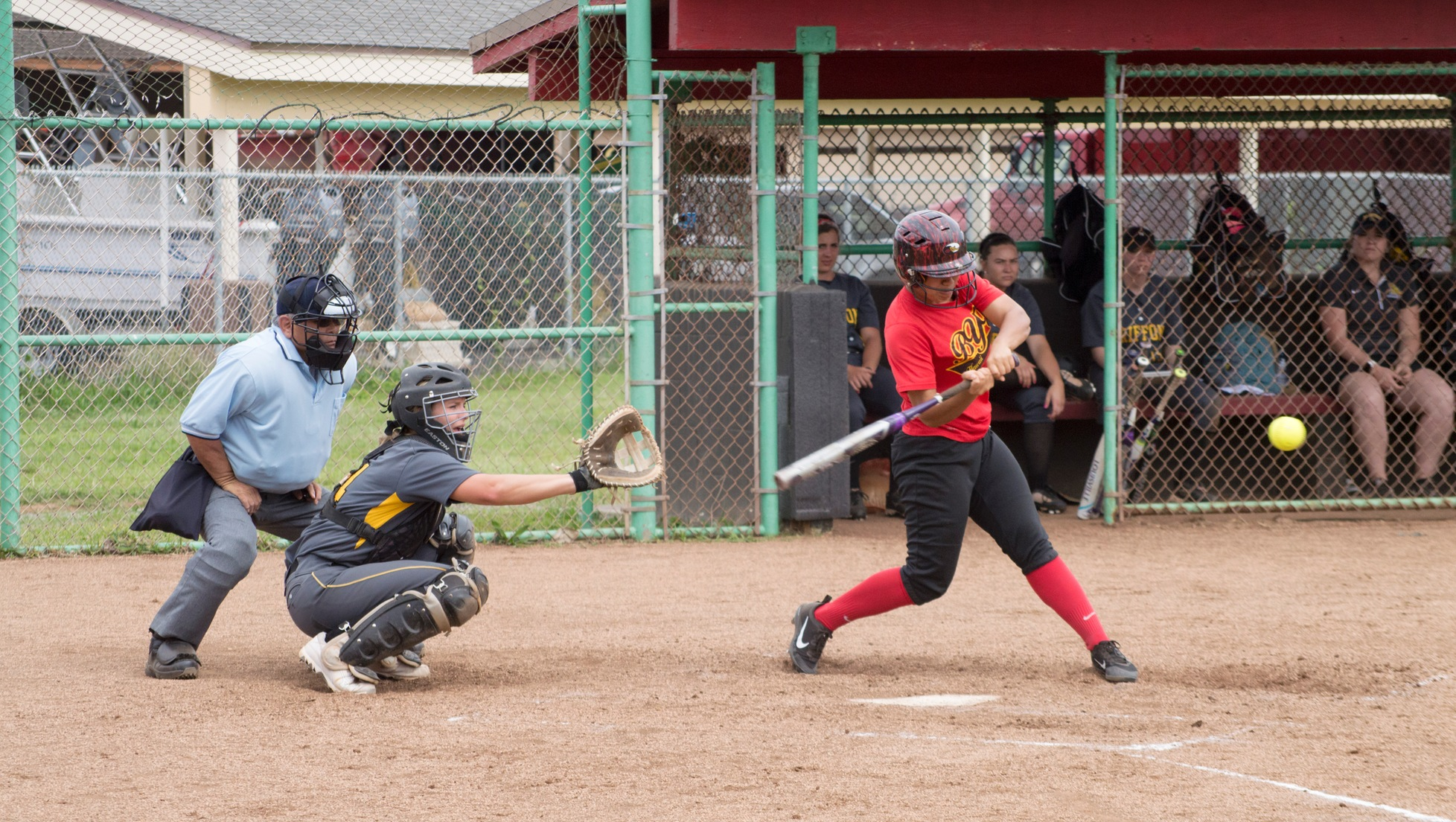 Liz Talataina sends a home run over the left-field fence to tie the game at three in the sixth inning.