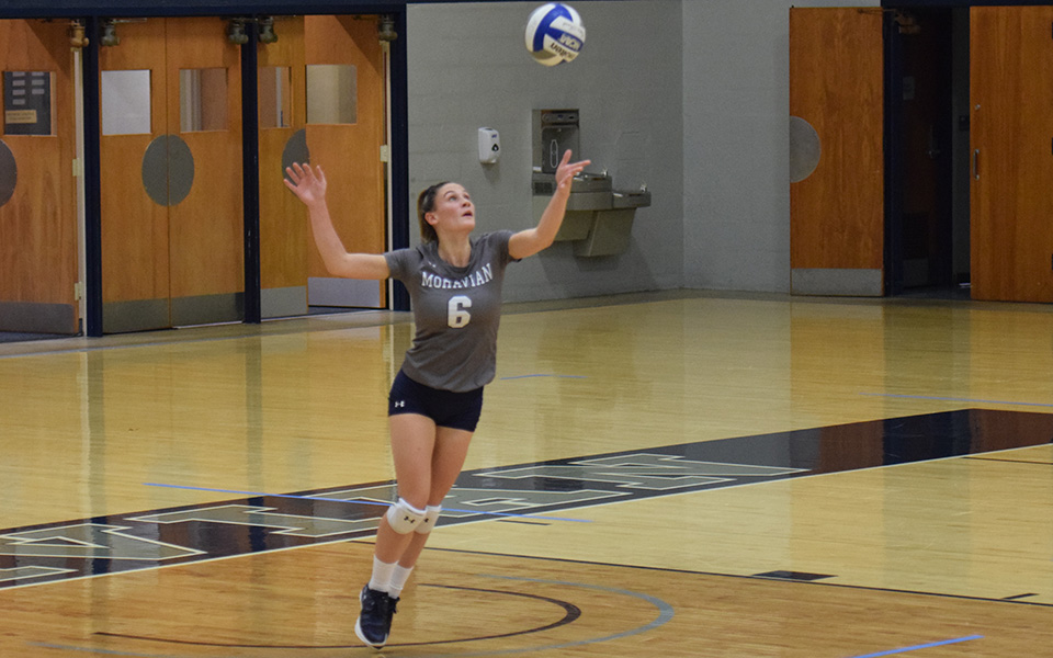 Brooke Kusmider goes up for a jump serve versus Susquehanna University in Johnston Hall.