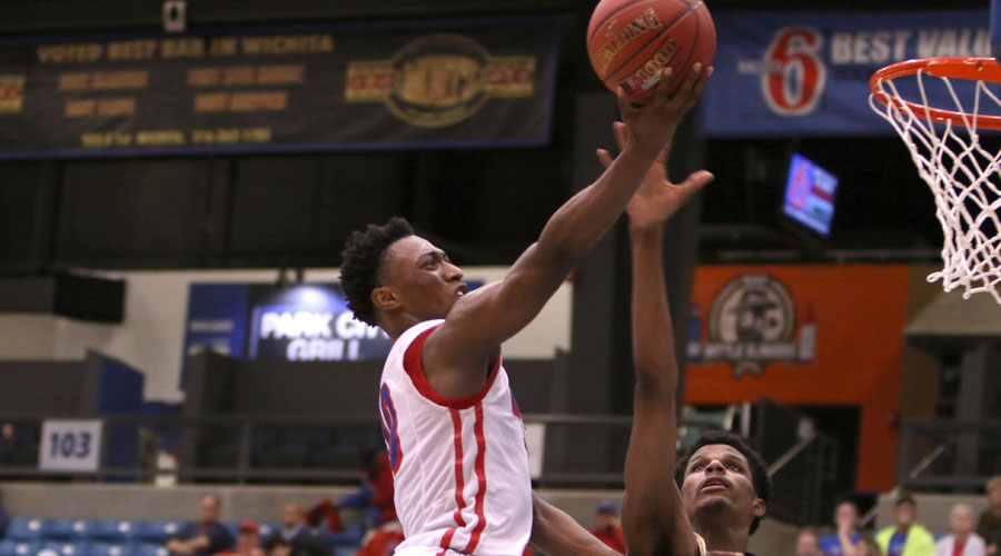 Devonte Bandoo scores two of his game-high 24 points in the Blue Dragons' 74-59 victory over Independence in the Region VI Tournament on Sunday at Hartman Arena in Park City. (Joel Powers/Blue Dragon Sports Information)