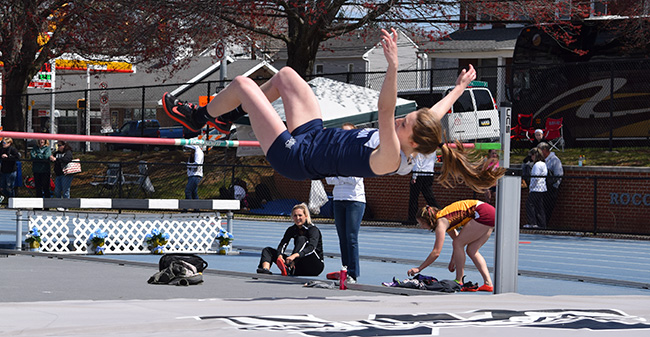 Casie Cronk '18 clears the high jump bar in the Greyhound Invitational at Timothy Breidegam Track.