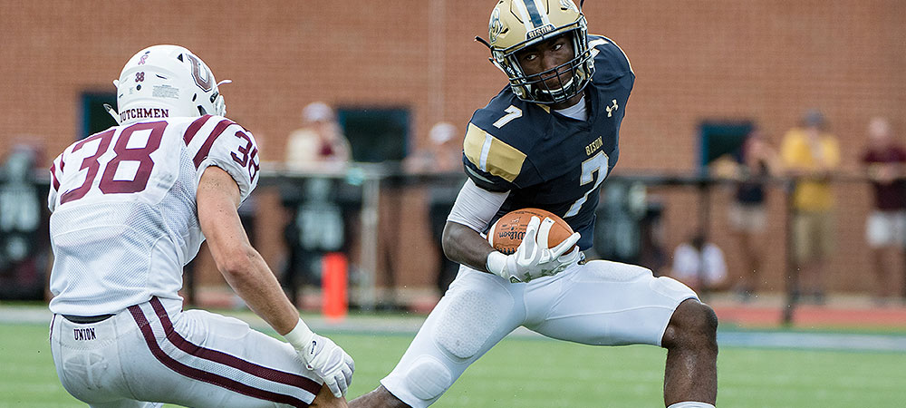Gallaudet running back Darrion Green runs the ball to the right of the screen as he tries to dodge an Union defender.