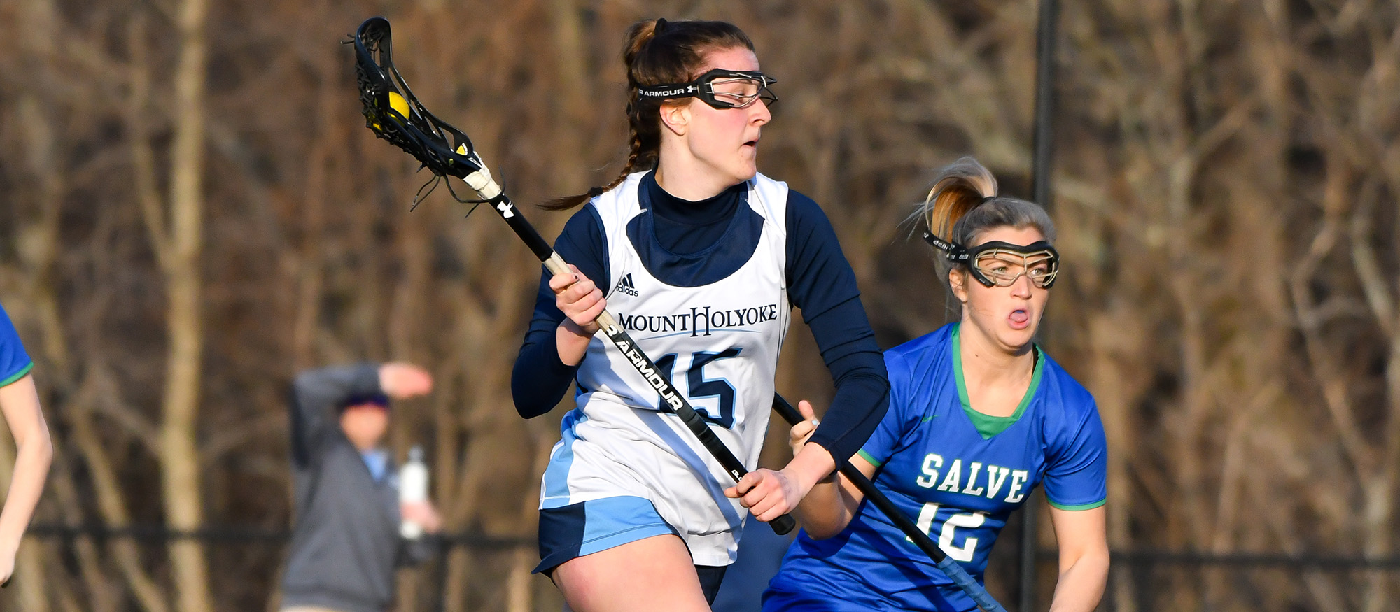 Action photo of Lyons lacrosse player, Abby Baldwin.