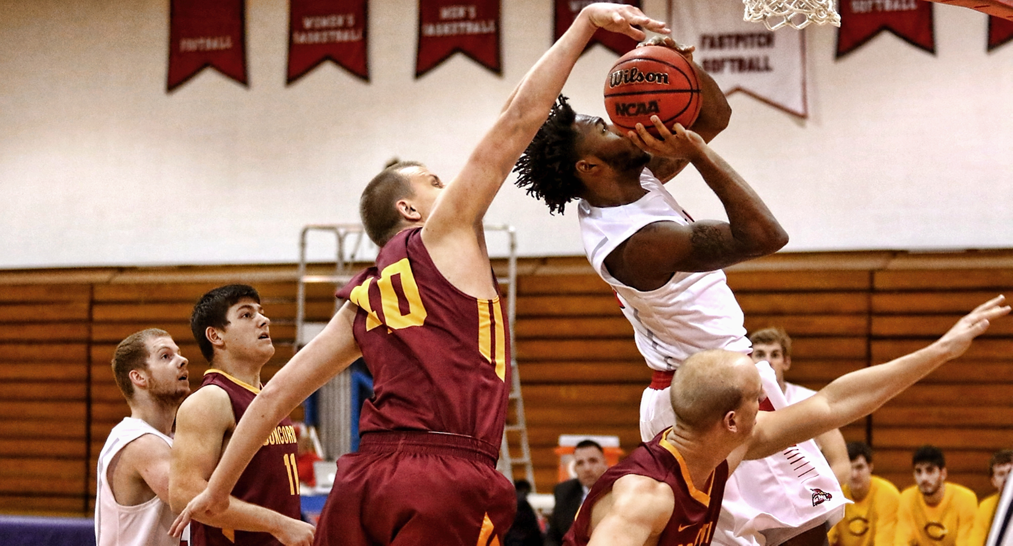Junior Austin Heins goes for the block in the Cobbers' win at St. Mary's. Heins had 13 points in the team's third win of the year. (Photo courtesy of Ryan Coleman, D3photography.com)