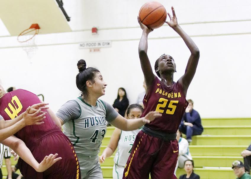 Lancer Mercy Odima goes up for a shot attempt during PCC's loss at East Los Angeles College, photo by Richard Quinton.