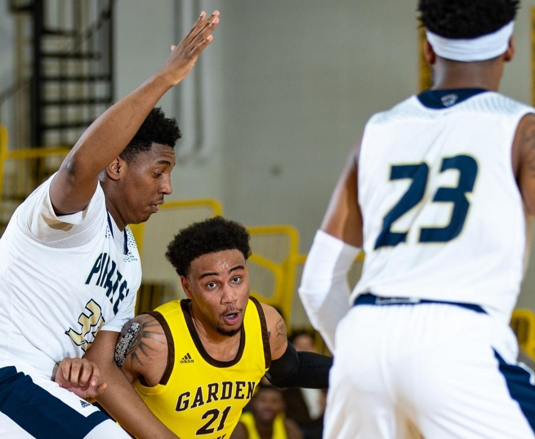 Indy sophomore Jibril Harris(33) defends Broncbusters freshman Tony Hopkins(21) in the 70-65 win over Garden City Community College. Photo by Shrimplin Photography