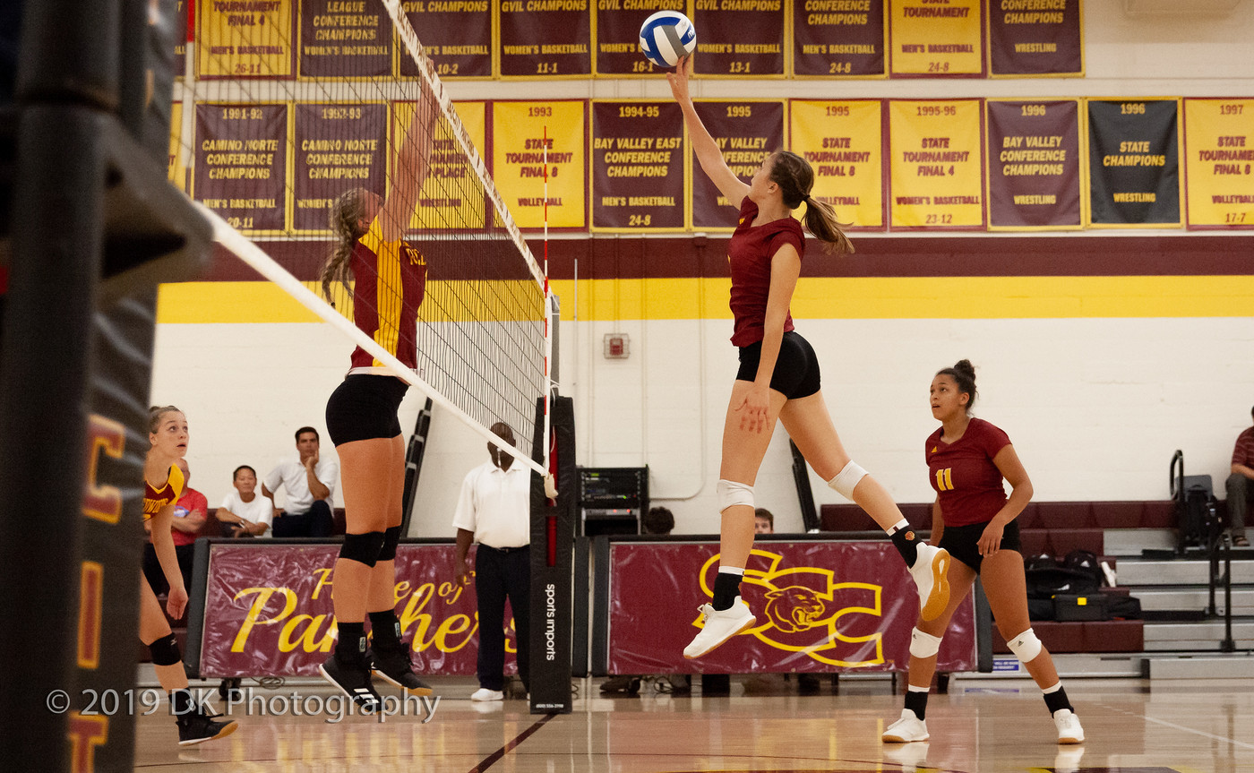 Sierra Reusche (#5), City College freshman tips the ball in the match against Redwoods College in the North Gym on Sept. 4th.