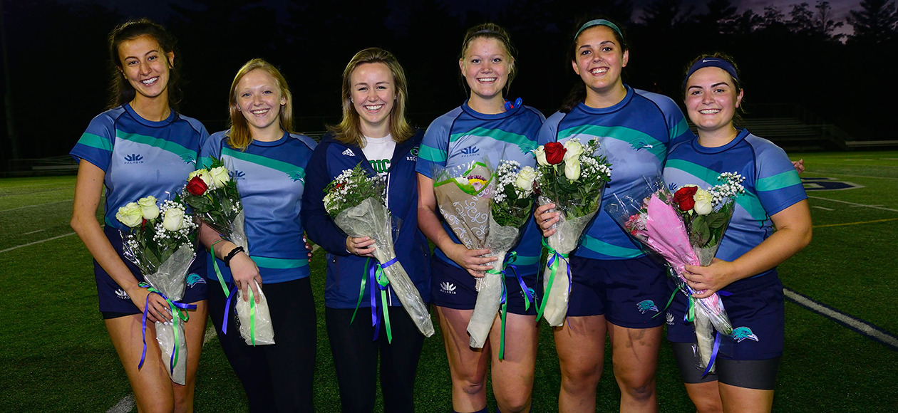 Endicott women's rugby seniors pose for a photo.