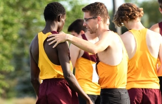 Munir Isahak (L) and Eric Wicklund grew up in different worlds but have become united in running for the Cobbers.