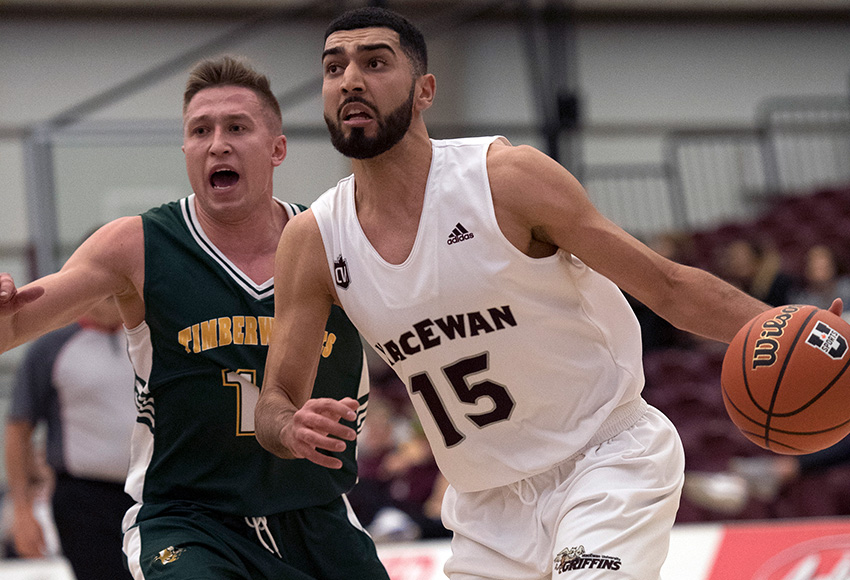 MacEwan's Ali Raza is watched by UNBC's Volodymyr Pluzhnikov on Friday. Both players led their respective teams in scoring (Chris Piggott photo).