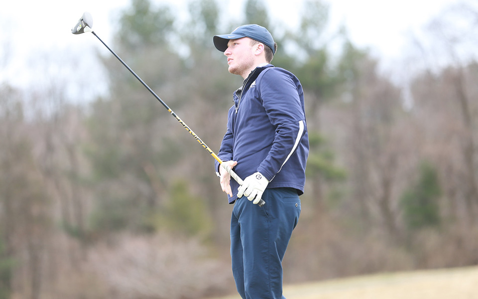Senior Kody Long watches a shot during the Alvernia University Invitational at the LedgeRock Golf Club. Photo courtesy of Alvernia Athletic Communications.
