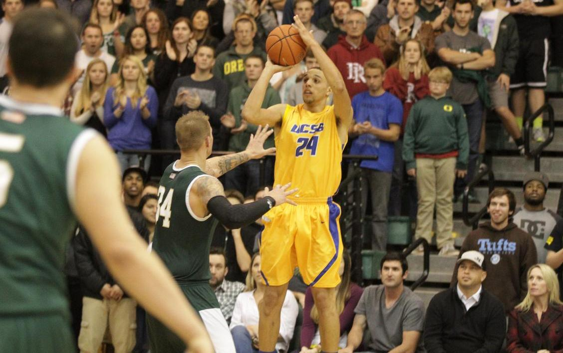 Michael Bryson launches a three-pointer to give UCSB a 46-42 lead with 1:18 to play on Saturday night at Cal Poly. The Gauchos used a 20-5 game-ending run to win, 50-45. (Photo by Gerry Fall, Santa Barbara News-Press)