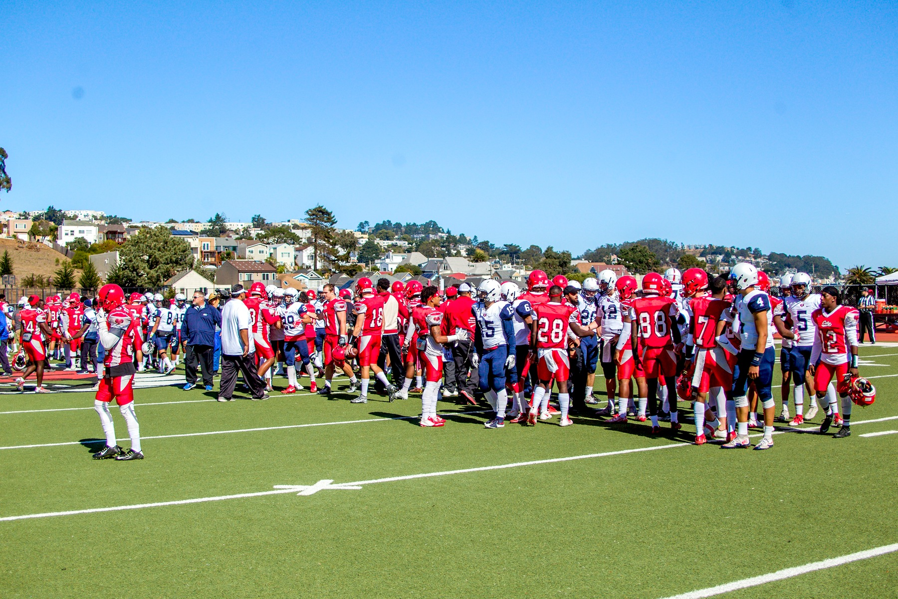 CCSF meet the SRJC players to exchange handshakes before the game.