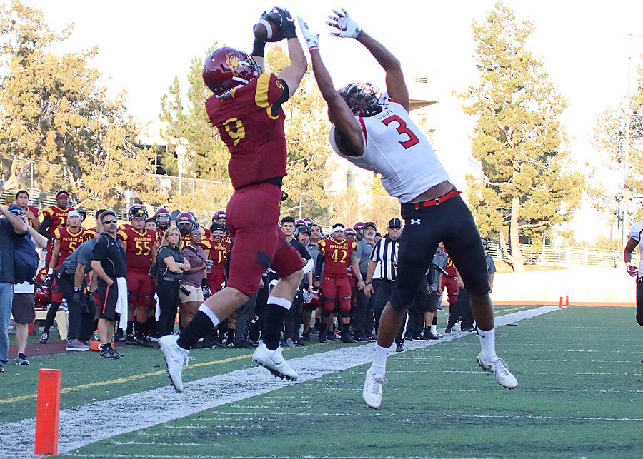 Forest Fajardo hauls in PCC's lone touchdown in the first quarter of Saturday's loss v. Chaffey, photo by Richard Quinton.