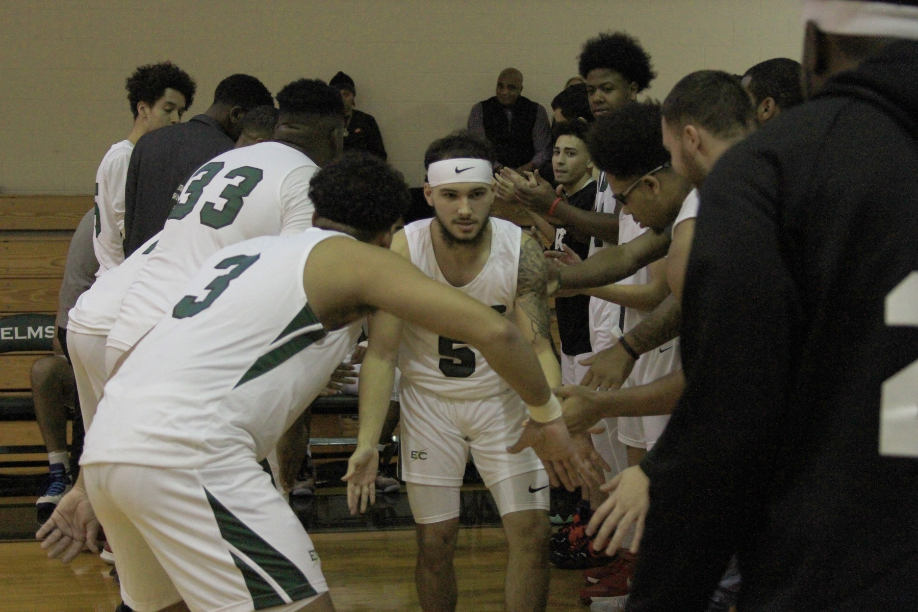 Men's Hoops Falls In John K. Adams Opener