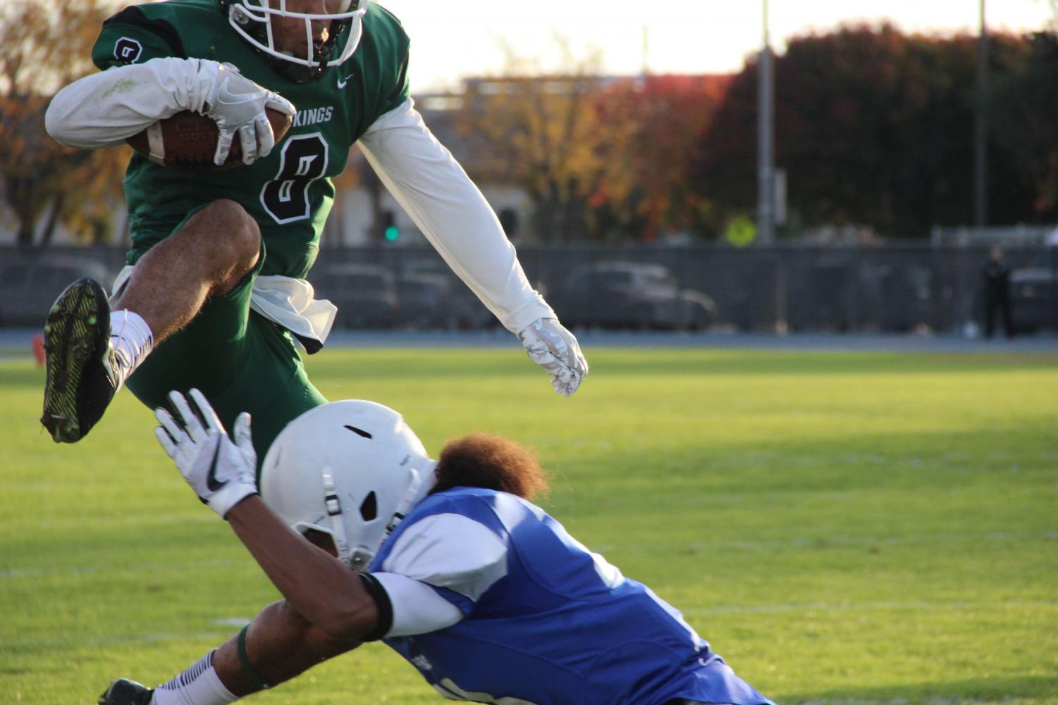 Photo of the night: Wide receiver Cameron Norfleet shows off his athleticism by hurdling over his defender. Norfleet had nine catches for 100 yards in the Gridiron Bowl game at Modesto Junior College in Modesto, California on November 18, 2017. | Photo by Aaron Tolentino