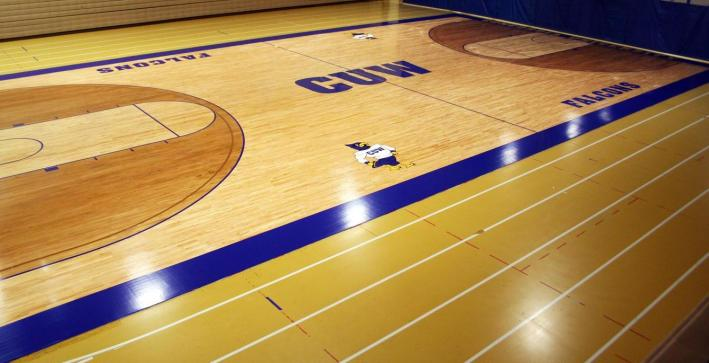 Photo gallery update: R. John Buuck Field House floor gets new look