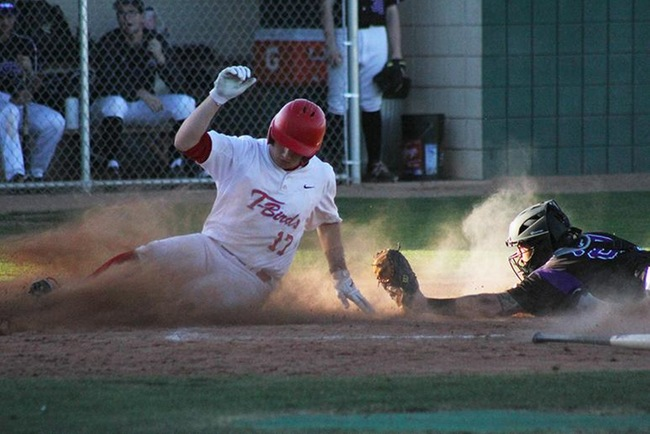 Mesa's Ben Lewis slides in safely past the out stretched arm of the Grand Canyon Club catcher. (Photo by Aaron Webster)