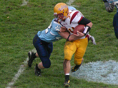 Skyler Stoker tries to break a tackle in the game (Photo by Sandy Gholston)