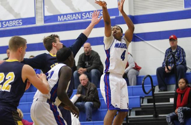 Oliver, Sabres shoot their way to win over Spartans