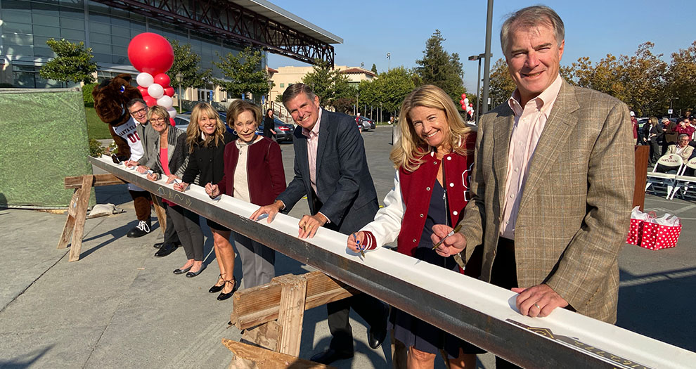 Donors Lead Beam Signing for Athletic Excellence Center
