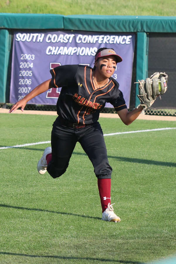 PCC rightfielder Leilani Montanez makes a running catch in the team's game at Mt. San Antonio College on April 3, photo by Richard Quinton.