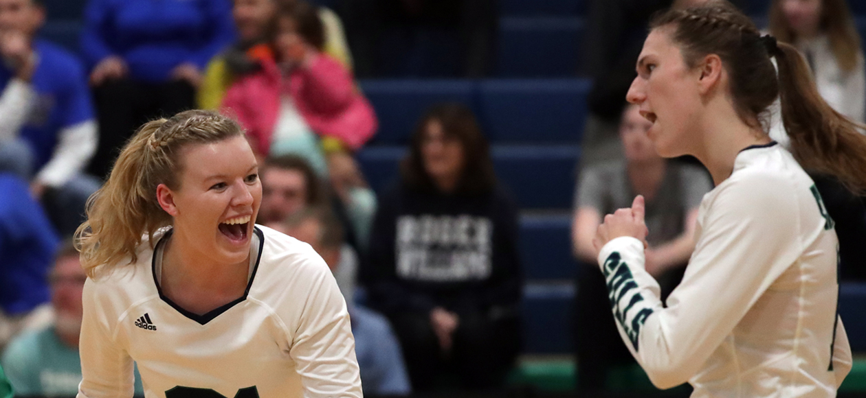 Image of Zoey Gifford and Emma Mancini celebrating a point against Roger Williams.