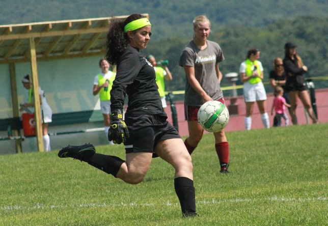 Leandra Flores-Nieves kicks the ball vs. Southern Vermont - Women's Soccer