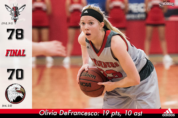Olivia DeFrancesco looks to pass the basketball.