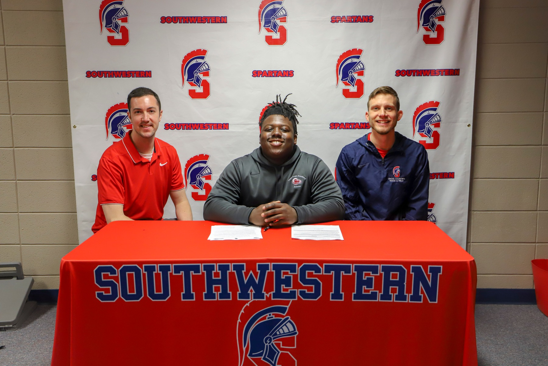 Marquez Jenkins of Kansas City, Missouri, signs his National Letter of Intent to throw for the Southwestern track and field team.
