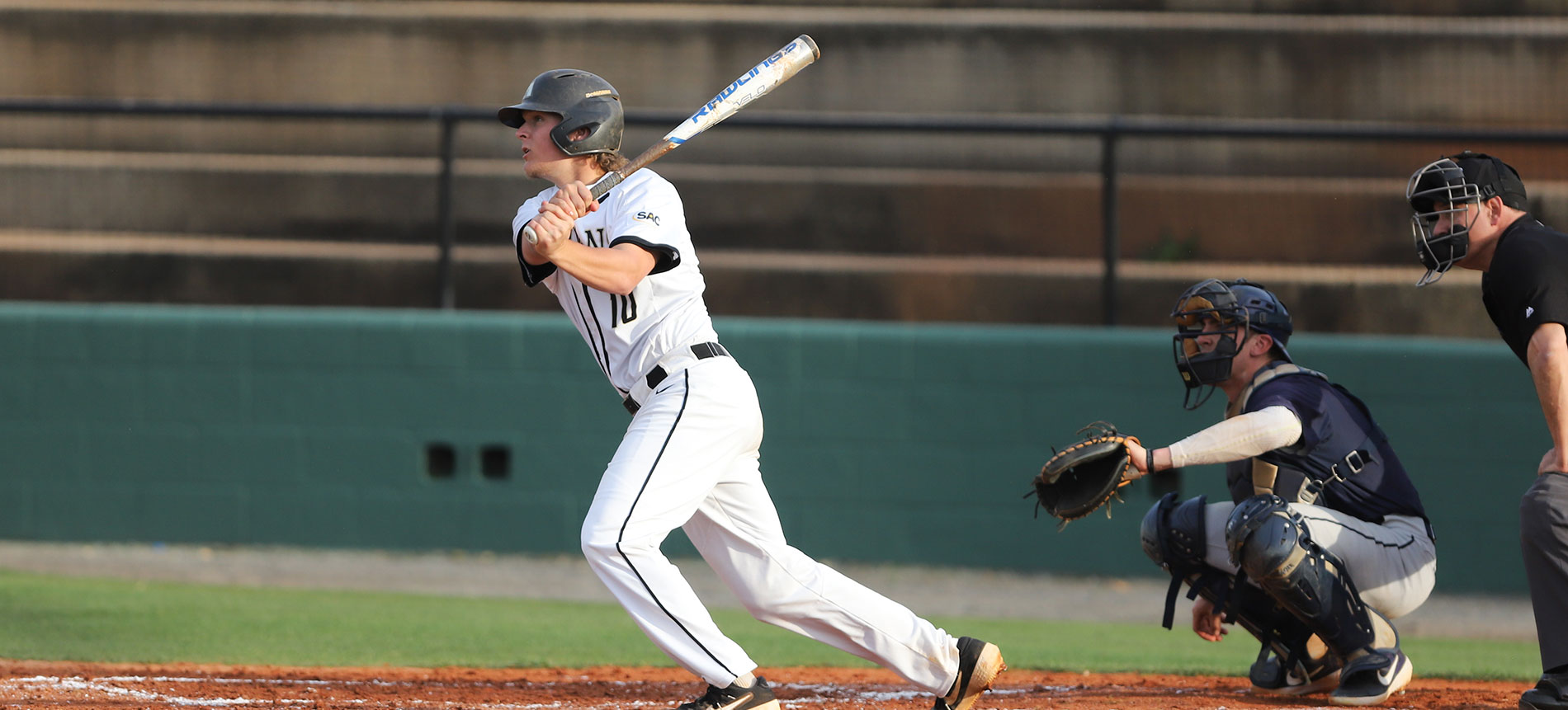 Trojans Split Crucial South Atlantic Conference Doubleheader with Coker