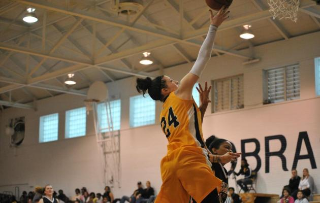 Lau Helps Cobras Overthrow Royals, 71-68