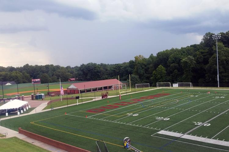 Storm clouds containing lightning and rain roll into Armfield Athletic Center Saturday afternoon.