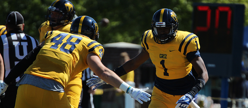 Deontez Alexander (1) celebrates the first of his two touchdowns with TE Kole Butler (48)