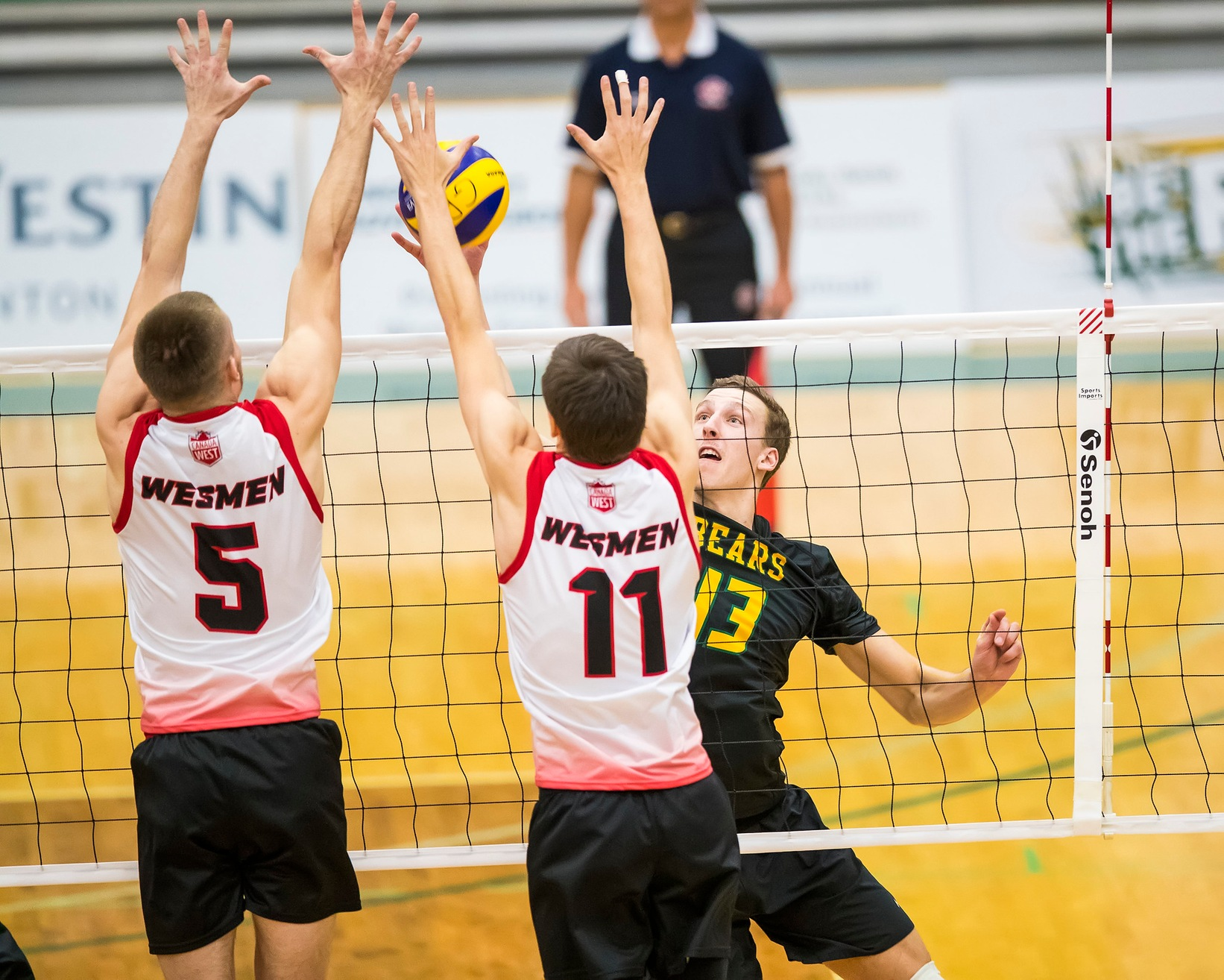 Keegan Teetaert (5) and Mikael Clegg team up to try and block an Alberta attack during men's volleyball action Friday night in Edmonton. (Dan Voaklander photo)