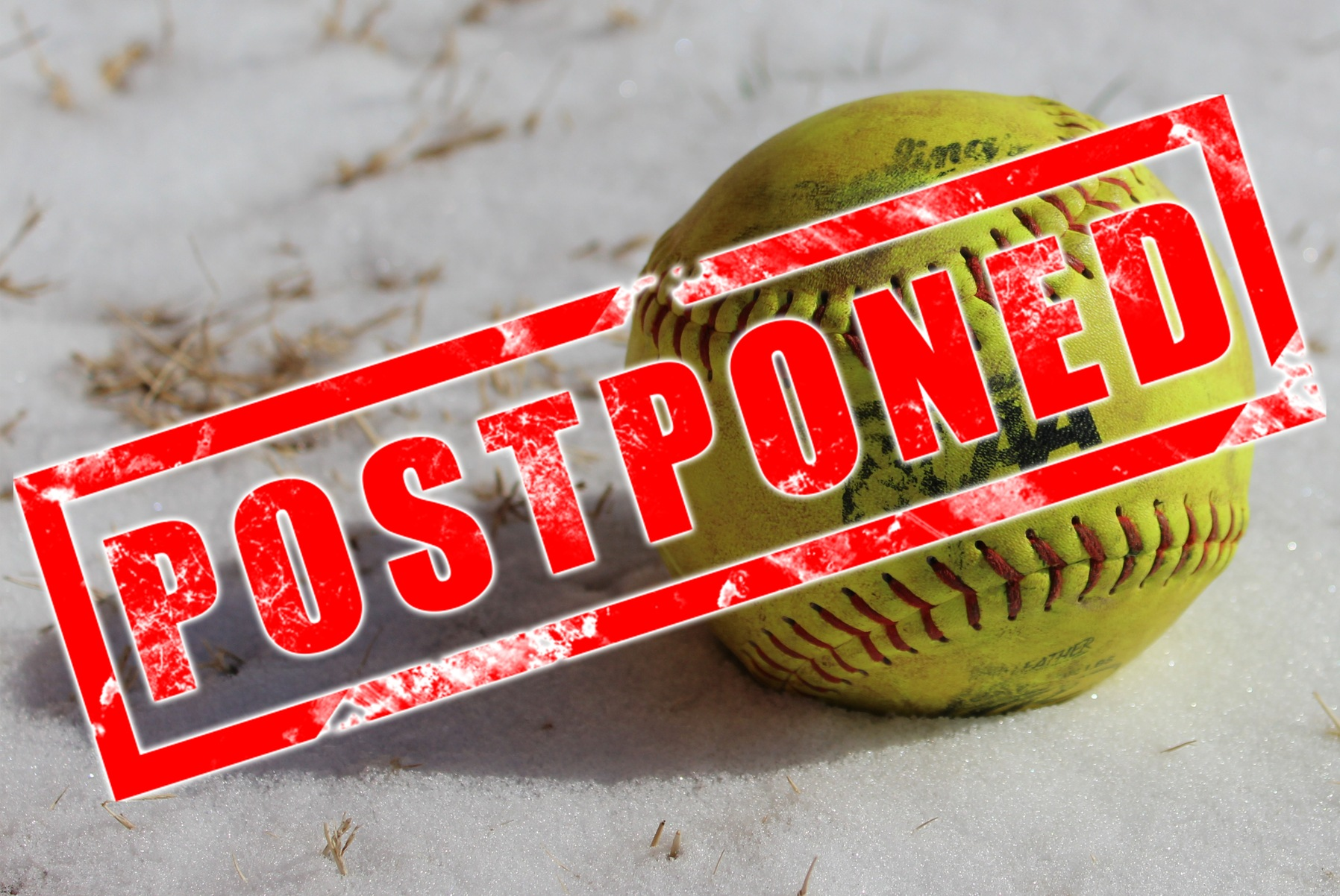 A softball in the snow. Text: Postponed