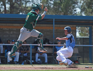 Baseball Splits Doubleheader To Open Season