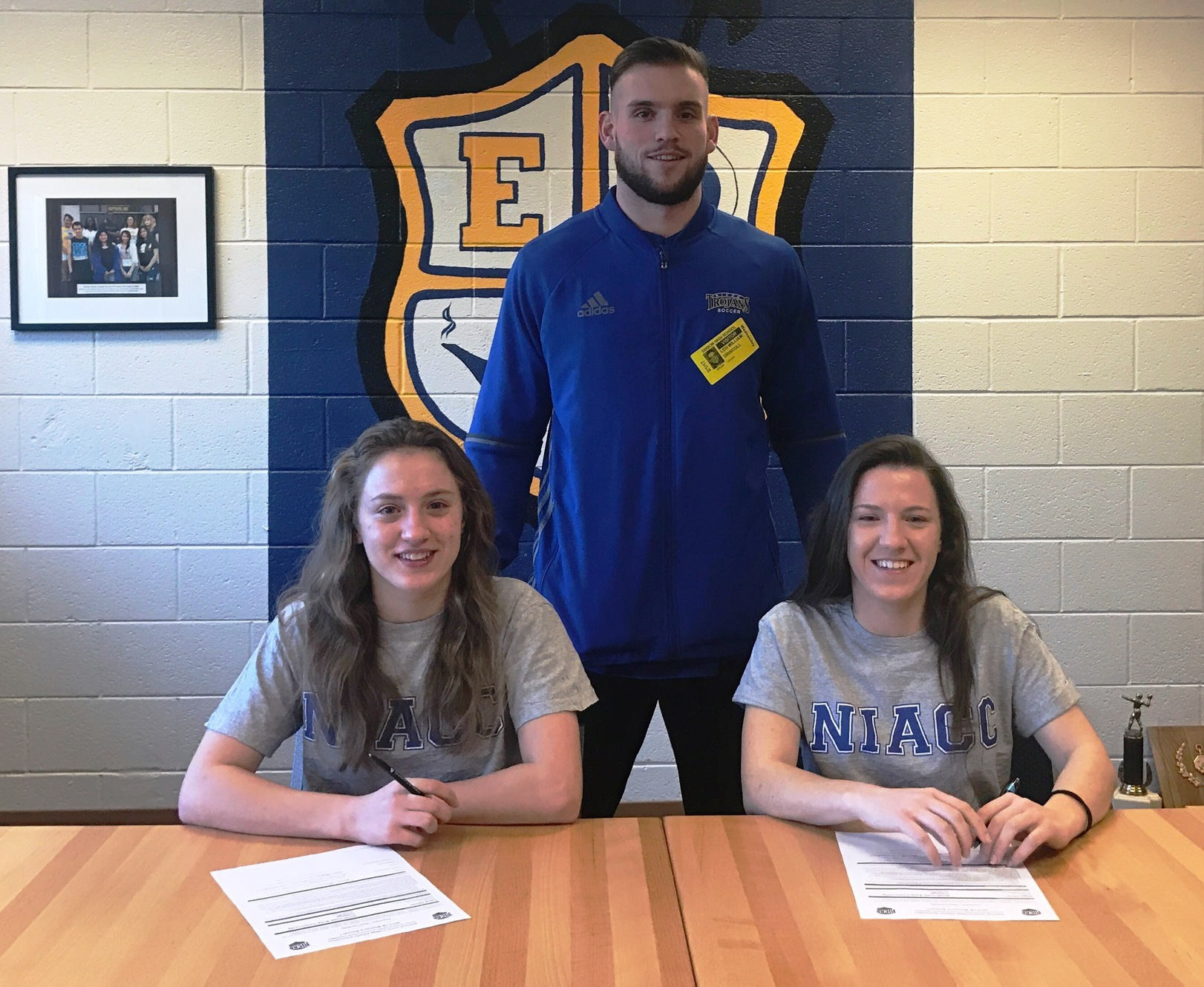 Lena Oliver (left) and Olga Oliver from Minneapolis recently signed a national letter of intent to play soccer at NIACC in the fall of 2017. NIACC coach pictured is Leo Driscoll.