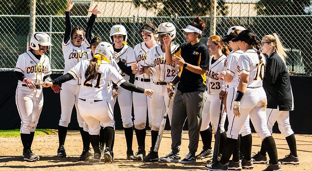 Allie Dobbs (#21) touches home plate after hitting her state-leading ninth home run against Reedley College. (Photo by Augustin Duenas)