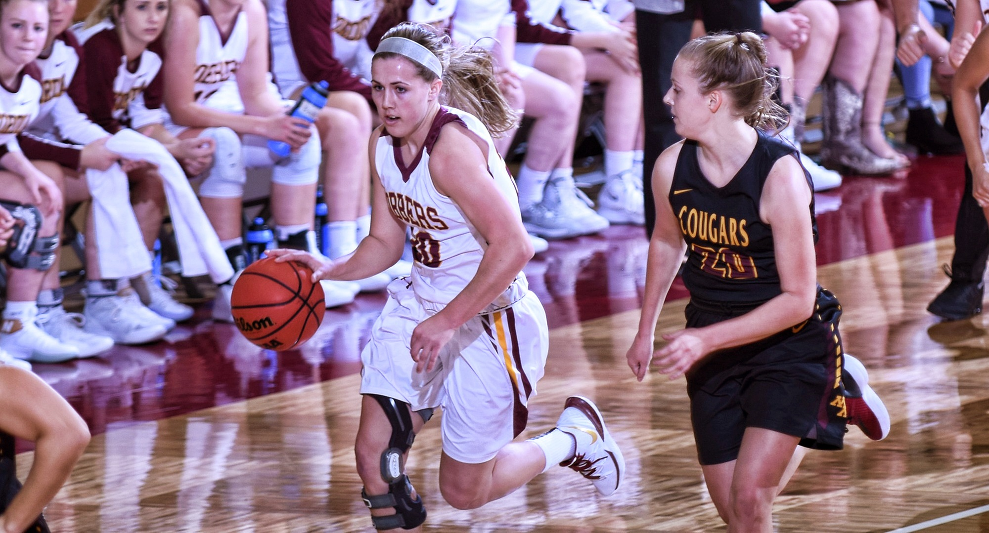 Freshman Emily Beseman brings the ball up the court against a Minn.-Morris defender during the Cobbers' 78-63 win. Beseman finished with 23 points in her college debut.