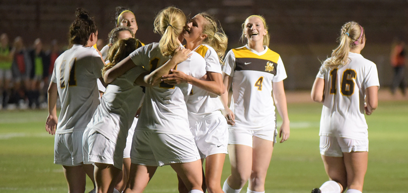 The women's soccer team celebrates a goal (Photo by William Lekan)