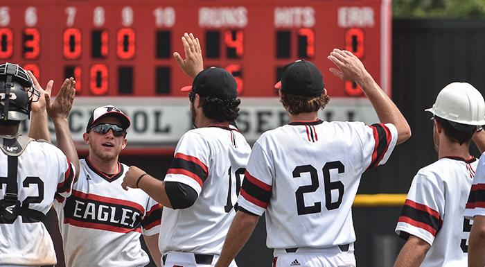 The Eagles celebrate after defeating Gulf Coast 6-4 in the state baseball tournament. (Photo by Tom Hagerty, Polk State.)