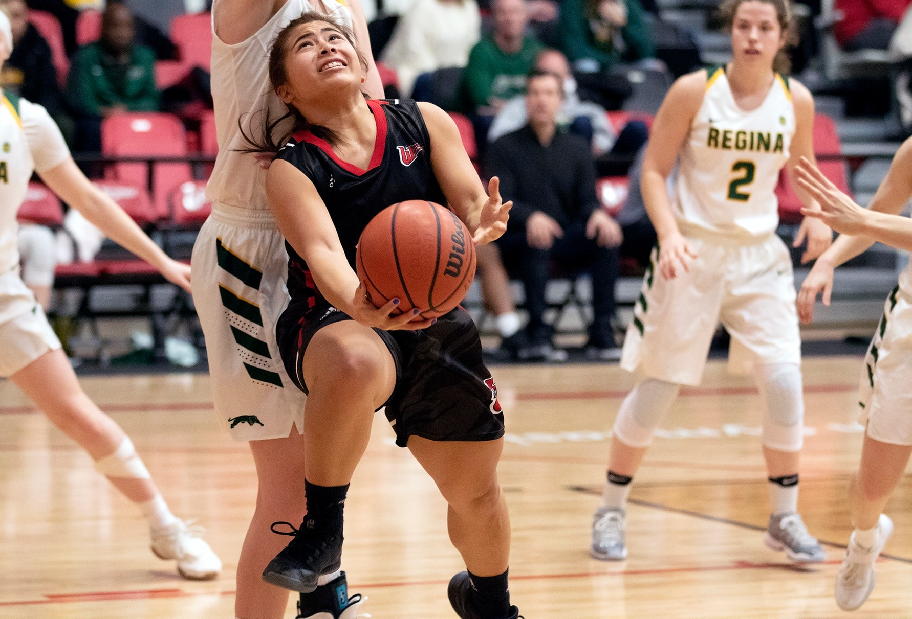 Tournament all-star Farrah Castillo goes to a reverse lay-up against the Regina Cougars in the final of the Wesmen Classic on Sunday, Dec. 30, 2018. (Shanlee McLennan/Wesmen Athletics)