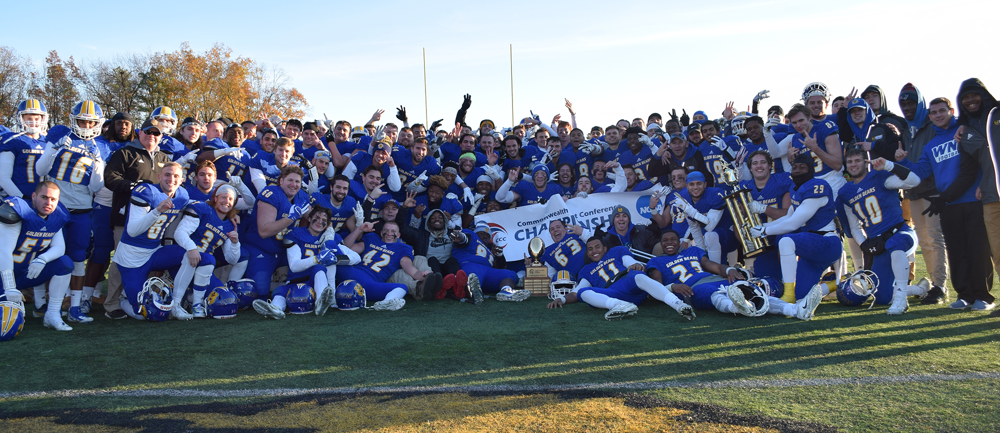 Western New England was presented with the CCC Football Championship trophies at the conclusion of Saturday's 55-14 victory over Nichols at Golden Bear Stadium (photo by Rachael Margossian).