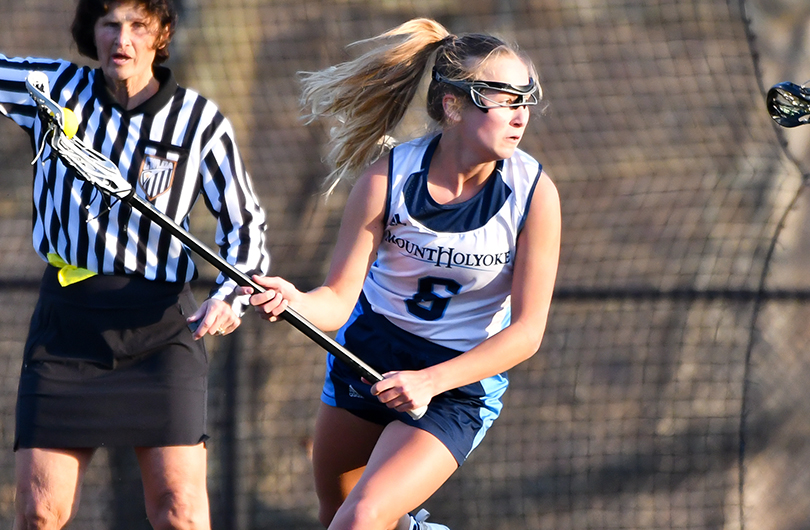 Action photo of Lyons lacrosse player, Caroline Flynn