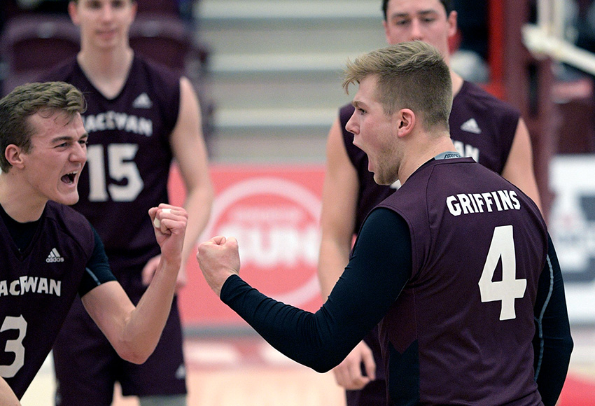 Shane Kerrison, right, celebrates one of his 23 kills on Friday with teammate Jordan Peters (Chris Piggott photo).