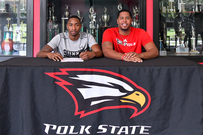 Malcolm Stevenson (left) signs letter of intent with Head Coach Brandon Giles. (Photo by Tom Hagerty, Polk State.)