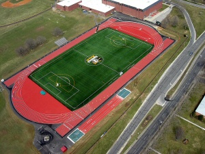 Aerial photo of soccer/lacrosse field with track surrounding.
