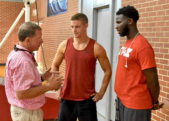 Huntingdon head coach Mike Turk welcomes back seniors Chase Young (center) and Otis Porter (right) for the start of preseason camp. More than 140 players reported on Tuesday.